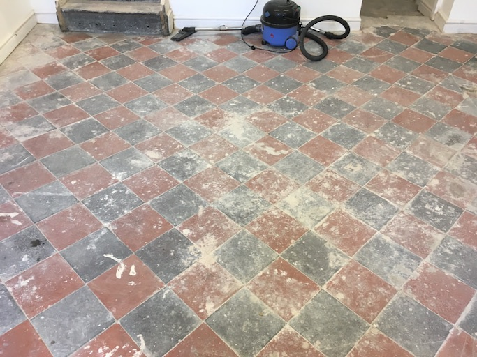 Quarry tiled floor before cleaning