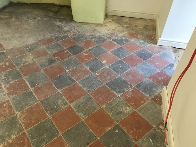 Quarry tiled floor in Oswestry before cleaning
